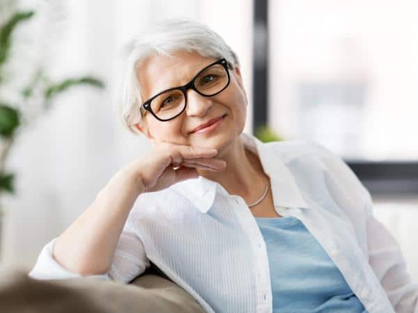 portrait of smiling senior woman with glasses