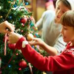Happy children decorating a Christmas tree